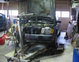 Mercedes on ramps with engine hoist